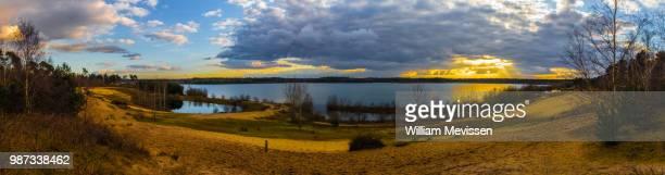 panorama 'cloudy sunset' - william mevissen bildbanksfoton och bilder