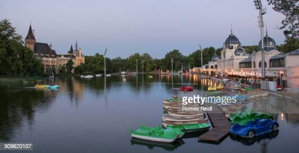 Panorama from the Budapest City Park Ice Rink with the Vajdahunyad castle and the boating lake at nightfall