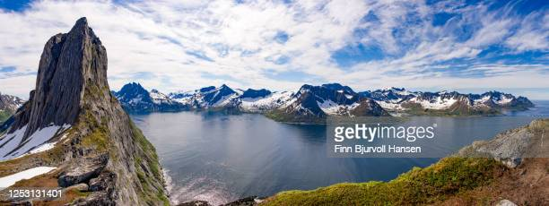 panorama from the trailhead hesten at the island of senja in northern norway. the famous mountain segla to the left - finn bjurvoll stock pictures, royalty-free photos & images