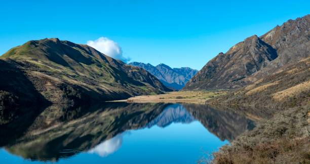Panorama, mountains reflected in a lake, Moke Lake near Queenstown, Otago, South Island, New Zealand