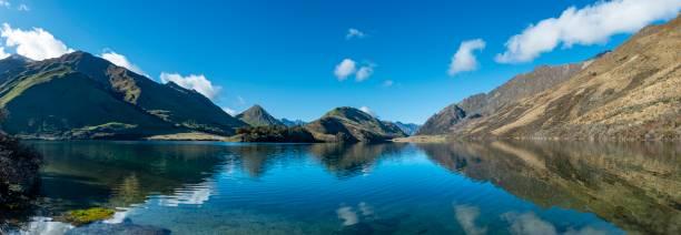 Panorama, mountains reflecting in lake, Moke Lake near Queenstown, Otago Region, Southland, New Zealand