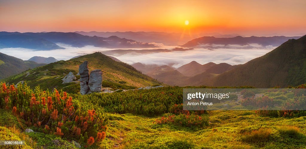 Panorama of a beautiful sunrise Panorama of a beautiful sunrise in the mountainsin the mountains : Stock Photo