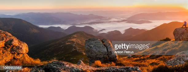 panorama of a misty dawn in the mountains. beautiful landscape - anton petrus panorama of beautiful sunrise stock pictures, royalty-free photos & images
