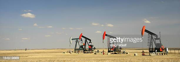 Panorama of a Row of Four Pumpjacks on the Great Plains