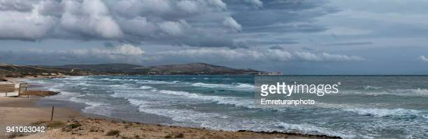 panorama of a sandy beach in cesme. - emreturanphoto stock pictures, royalty-free photos & images