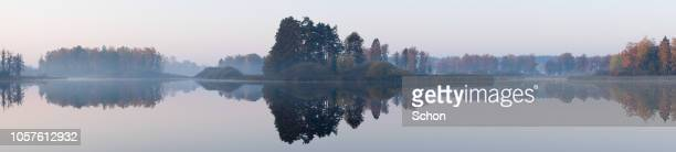 panorama of a still lake with islands a fall morning - 静かな情景 ストックフォトと画像
