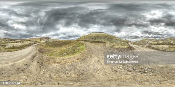 360° panorama of a very dramatic automotive scenery in iceland while summer on a f street in the icelandic highlands of vatnajökull nature reserve for cgi use. - hdri 360 ストックフォトと画像