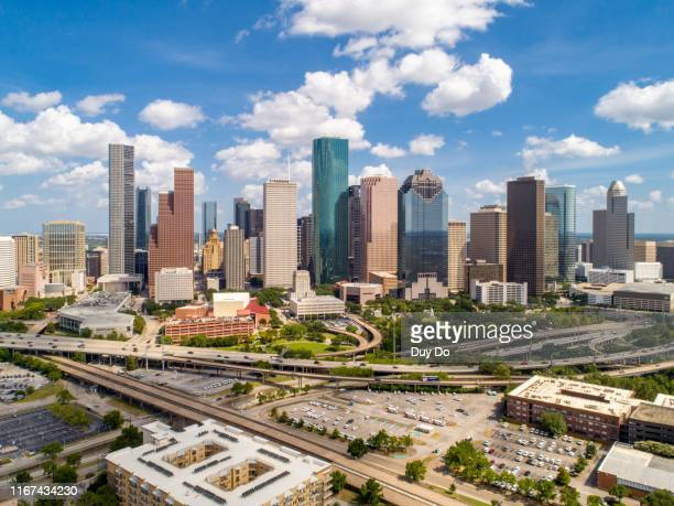 panorama of aerial view of downtown houston, texas, usa in a beautiful day. - texas stock pictures, royalty-free photos & images