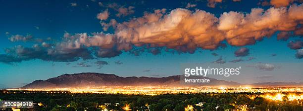 panorama of albuquerque skyline and sandia peak - new mexico stock pictures, royalty-free photos & images