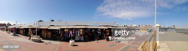 CONTENT] Panorama of Beach Promenade Souvenir Shops in Paracas Peru This town had been completely destroyed by a 2007 tsunami and has been rebuilt...