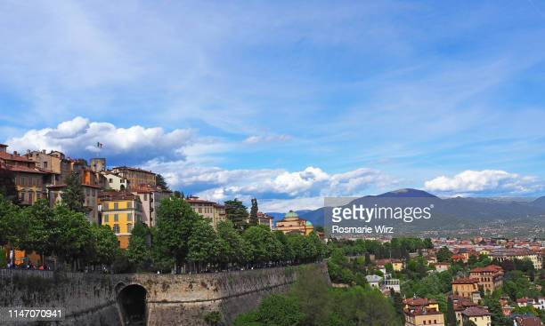 panorama of bergamo old town with venetian city wall. - bergame photos et images de collection