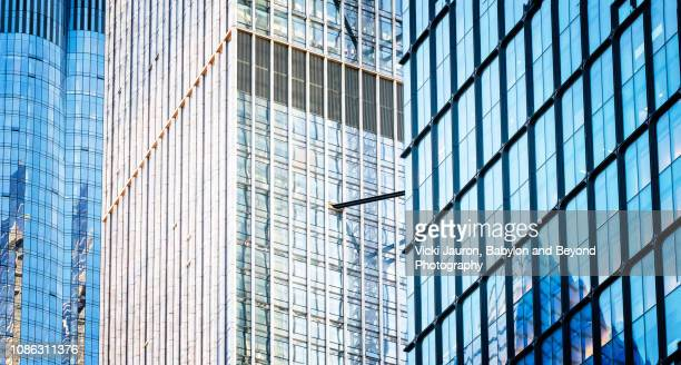 panorama of blue glass and reflections in hudson yards skyscrapers in nyc - hudson yards stock pictures, royalty-free photos & images