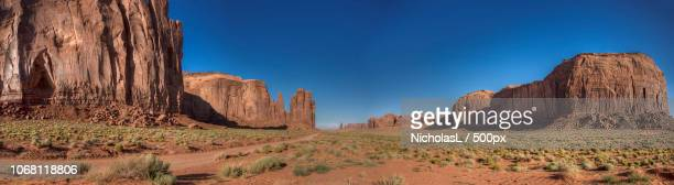 panorama of buttes in desert in monument valley - monument valley tribal park stock photos and pictures