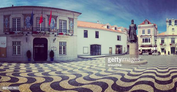panorama of cascais city hall and tourists sightseeing, portugal - cascais stock photos and pictures