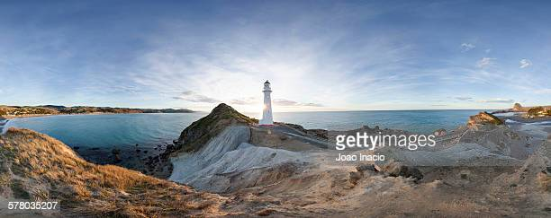 panorama of castlepoint lighthouse - wellington new zealand stock photos and pictures