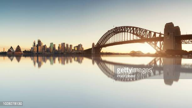 panorama of cityscape image of sydney, australia with harbour bridge and sydney skyline during sunrise. - sydney stock pictures, royalty-free photos & images