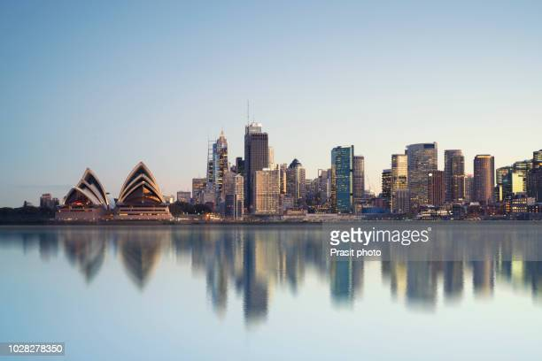 panorama of cityscape image of sydney, australia with harbour bridge and sydney skyline during sunrise. - day stock pictures, royalty-free photos & images