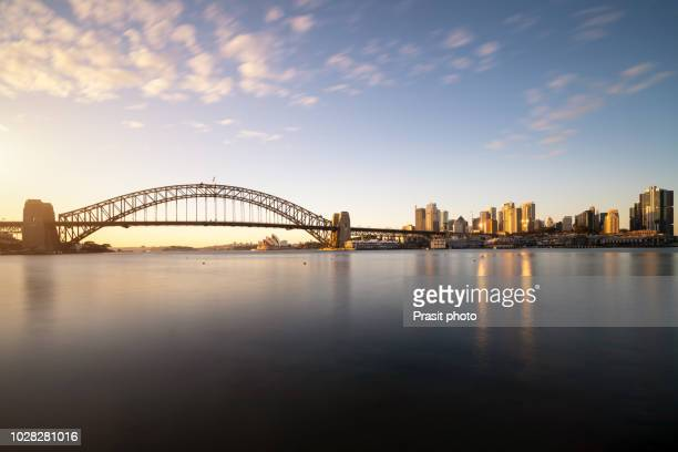 panorama of cityscape image of sydney, australia with harbour bridge and sydney skyline during sunrise. - new bay bridge stock pictures, royalty-free photos & images