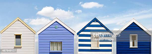Panorama of colorful blue white Beach Huts at the Beach of Southwold England