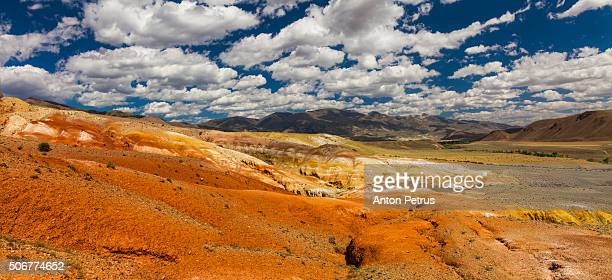 Panorama of desert with colored slopes