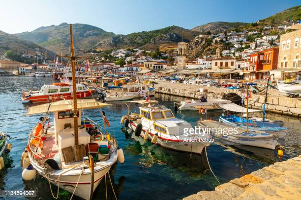 panorama of fishing boats on hydra island, greece - hydra greece photos stock pictures, royalty-free photos & images