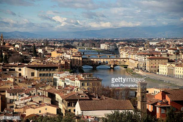 panorama of florence with the arno river, as seen from the hill of san miniato's church - san miniato stock pictures, royalty-free photos & images