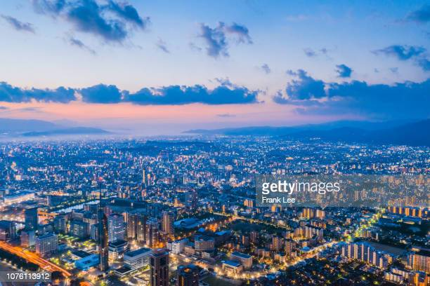 panorama of fukuoka tower aerial view from drone at sunset along with momochi beach, fukuoka prefecture, japan - fukuoka city stock pictures, royalty-free photos & images