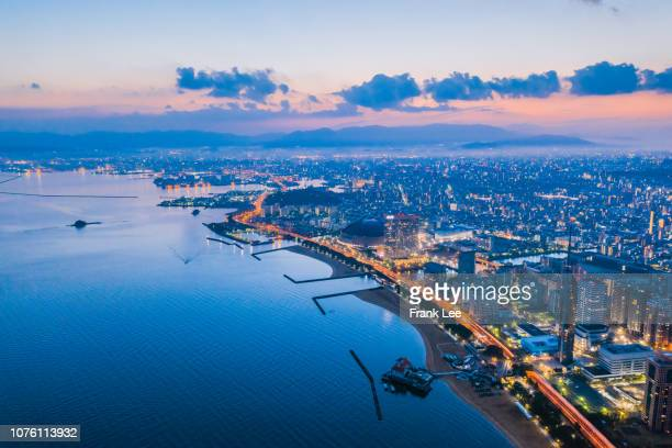 panorama of fukuoka tower aerial view from drone at sunset along with momochi beach, fukuoka prefecture, japan - 福岡県 ストックフォトと画像