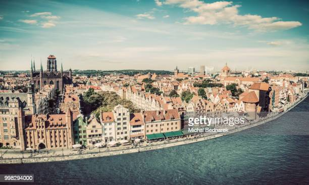 panorama of gdansk old town and motlawa river in poland. vintage - motlawa river stock pictures, royalty-free photos & images