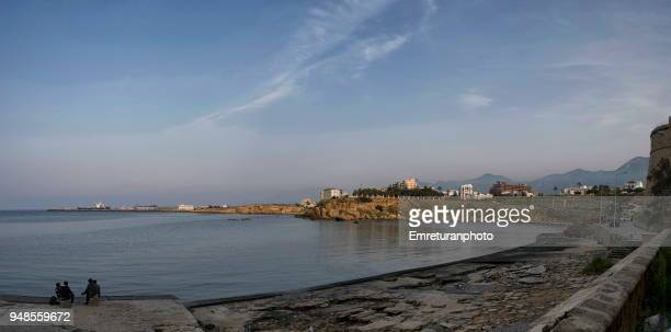 panorama of girne harbor at sunset in northern cyprus. - emreturanphoto stock pictures, royalty-free photos & images