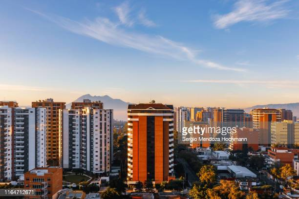 a panorama of guatemala city early in the morning - guatemala city stock pictures, royalty-free photos & images