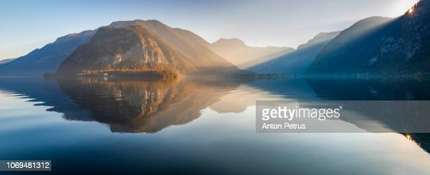 panorama of hallstatter lake at sunrise, austria - anton petrus panorama of beautiful sunrise stock pictures, royalty-free photos & images