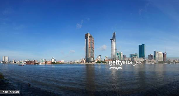 panorama of ho chi minh city riverside thu thiem with old and new buildings - thiem stock-fotos und bilder
