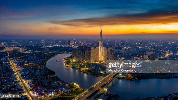 panorama of ho chi minh city skyline at sunset - people's committee building ho chi minh city stock pictures, royalty-free photos & images