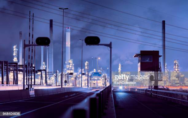 Panorama of illuminated oil refinery in Rotterdam at dawn