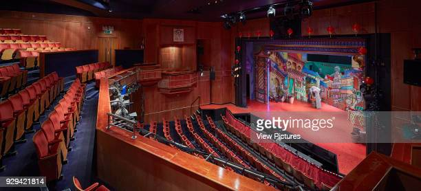 Panorama of illuminated theatre interior with stage Cambridge Arts Theatre Cambridge United Kingdom Architect Burrell Foley Fischer LLP 2014