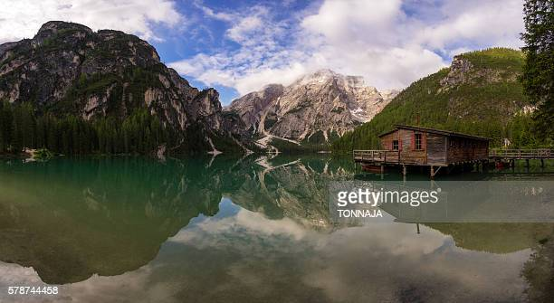 panorama of lago di braies, italy - toblach stock photos and pictures