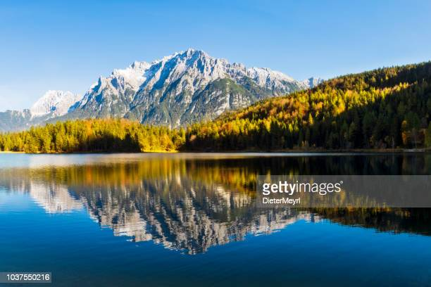 panorama of lautersee lake and wetterstein mountains, alps, bavaria, germany - mittenwald stock pictures, royalty-free photos & images