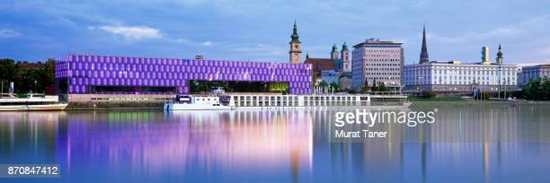 panorama of linz and the danube river at dusk - linz stock pictures, royalty-free photos & images