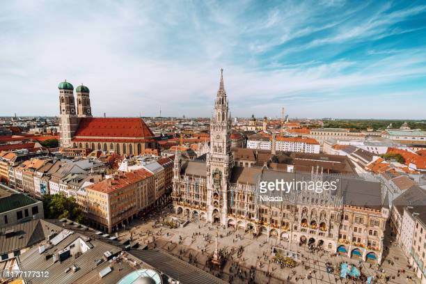 panorama of marienplatz square with new town hall and frauenkirche (cathedral of our lady). - munich stock pictures, royalty-free photos & images