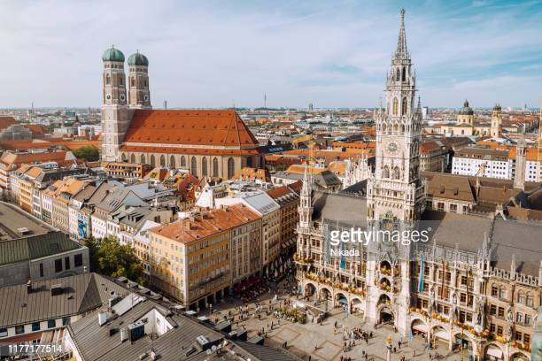 panorama of marienplatz square with new town hall and frauenkirche (cathedral of our lady). - marienplatz stock pictures, royalty-free photos & images