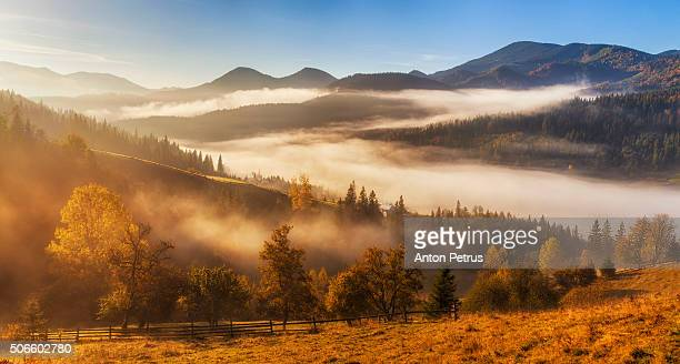 Panorama of misty sunrise in the mountains