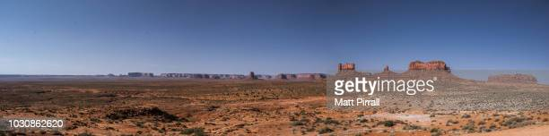 panorama of monument valley desert - monument valley tribal park stock photos and pictures