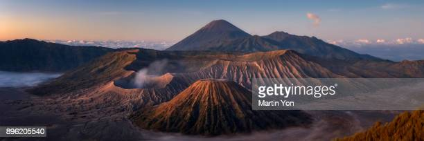 panorama of morning scene at mt.bromo - mt bromo stock photos and pictures