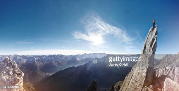 Panorama of mountain climber on summit