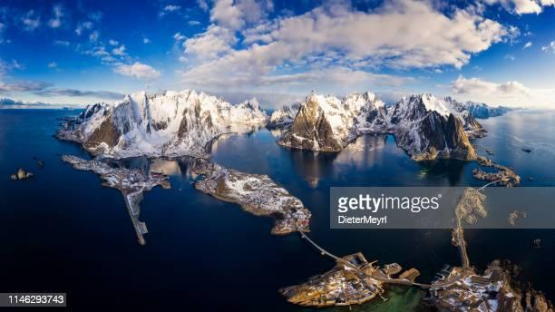 panorama of mountains and reine in lofoten islands, norway - xxxl panorama - lofoten stock pictures, royalty-free photos & images