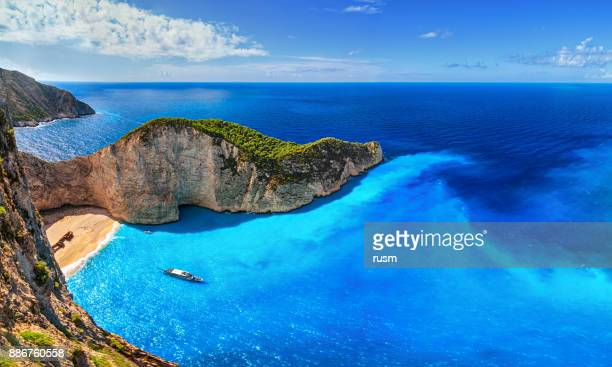 panorama of navagio beach (shipwreck beach), zakynthos island, greece. - greece stock pictures, royalty-free photos & images