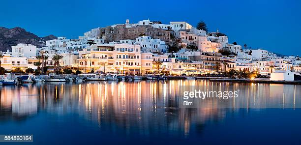 panorama of naxos illuminated at dusk, cyclades, greece - naxos stockfoto's en -beelden