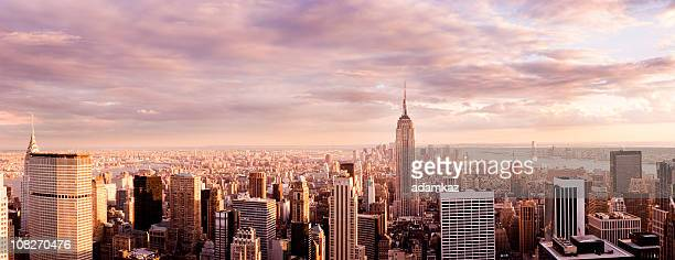 panorama of new york city skyline at sunset - new york city stock pictures, royalty-free photos & images