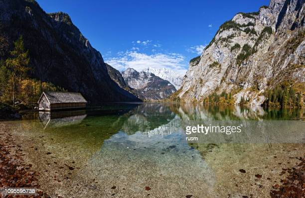 panorama of obersee lake in berchtesgaden park, germany - berchtesgaden national park stock photos and pictures